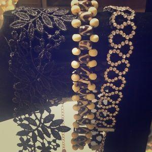 A set of three INC choker necklaces